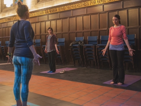 people doing yoga in a chapel
