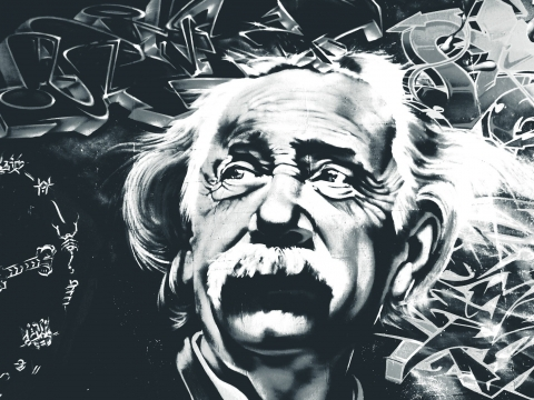 Street art painting of Albert Einstein in black and white on brick surface.